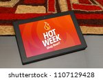 tablet over the table with hot... | Shutterstock . vector #1107129428