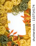 Note paper on various Italian pasta background - stock photo