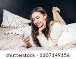 happy smiling girl in pajamas... | Shutterstock . vector #1107149156