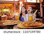 two young pretty girls eating...   Shutterstock . vector #1107149780