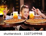 a young pretty girl eating...   Shutterstock . vector #1107149948