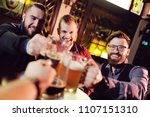 happy male friends clinking...   Shutterstock . vector #1107151310