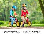 children riding balance bike.... | Shutterstock . vector #1107155984