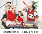 a family of fans watching a... | Shutterstock . vector #1107171149