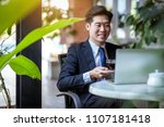 young businessman successful... | Shutterstock . vector #1107181418