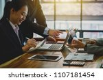business people discussing... | Shutterstock . vector #1107181454