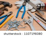 construction tools on wooden... | Shutterstock . vector #1107198380