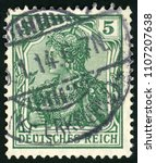 Small photo of GDR - CIRCA 1902: post stamp printed in Germany (Deutsches Reich) shows allegory Germania with imperial crown; mythological image of empire; Scott 67 A16 5 green; circa 1902