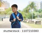 boy going to school.parent and... | Shutterstock . vector #1107210383