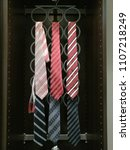 necktie hanging on rack hang... | Shutterstock . vector #1107218249