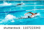 young man swimming freestyle in ... | Shutterstock . vector #1107223343