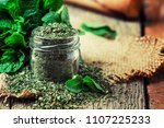 dried peppermint in a glass jar ... | Shutterstock . vector #1107225233
