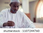 african muslim man making... | Shutterstock . vector #1107244760