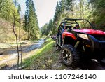 a tour group travels on atvs... | Shutterstock . vector #1107246140