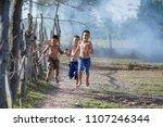 kids runing in rural thailand... | Shutterstock . vector #1107246344