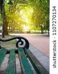 green city park. old wooden...   Shutterstock . vector #1107270134