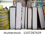 Books Stacked On A Shelf In A...