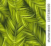 seamless pattern of palm leaves.... | Shutterstock .eps vector #1107338330