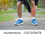 young fitness man holding his... | Shutterstock . vector #1107353678