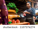 a girl selling tomatoes and... | Shutterstock . vector #1107376274