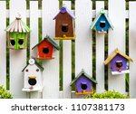 bird house on wood fence in the ... | Shutterstock . vector #1107381173
