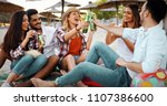 group of young friends laughing ...   Shutterstock . vector #1107386600