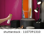 woman spraying air freshener at ... | Shutterstock . vector #1107391310