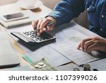 businessman working on desk in... | Shutterstock . vector #1107399026