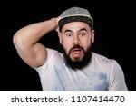 sad bearded football fan in cap ...   Shutterstock . vector #1107414470