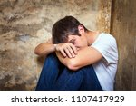 sad young man sit by the old... | Shutterstock . vector #1107417929