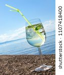 transparent beverage in wine... | Shutterstock . vector #1107418400
