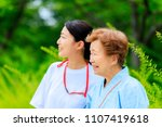 elderly women and caregivers | Shutterstock . vector #1107419618