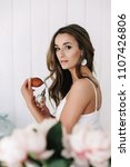 bride applying perfume. girl... | Shutterstock . vector #1107426806