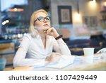 businesswoman looking through ... | Shutterstock . vector #1107429449