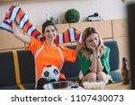 happy woman in oarnge fan t... | Shutterstock . vector #1107430073