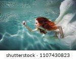 underwater girl. beautiful red... | Shutterstock . vector #1107430823