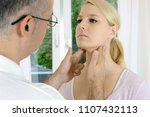 doctor at checkup palpates... | Shutterstock . vector #1107432113
