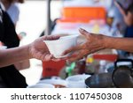 Small photo of Feeding the poor to alleviate hunger. give concept