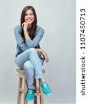 smiling young woman sitting on... | Shutterstock . vector #1107450713