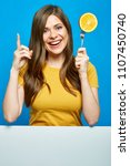 smiling woman holding fork with ... | Shutterstock . vector #1107450740