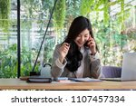 young businesswoman work with... | Shutterstock . vector #1107457334