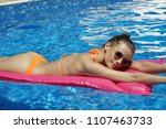 woman in bikini relaxing on air ... | Shutterstock . vector #1107463733