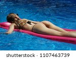 young woman in bikini relaxing... | Shutterstock . vector #1107463739