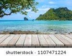 wooden desk or plank on sand... | Shutterstock . vector #1107471224