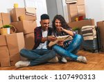 happy young couple moving into... | Shutterstock . vector #1107490313