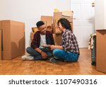 happy young couple moving into... | Shutterstock . vector #1107490316