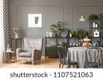 beige armchair against grey... | Shutterstock . vector #1107521063
