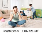 tired young nanny and little... | Shutterstock . vector #1107521339
