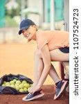 tennis player tying shoelaces...   Shutterstock . vector #1107524723