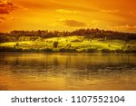 sunset over lake and blossoming ... | Shutterstock . vector #1107552104